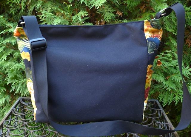 large purse with adjustable shoulder strap