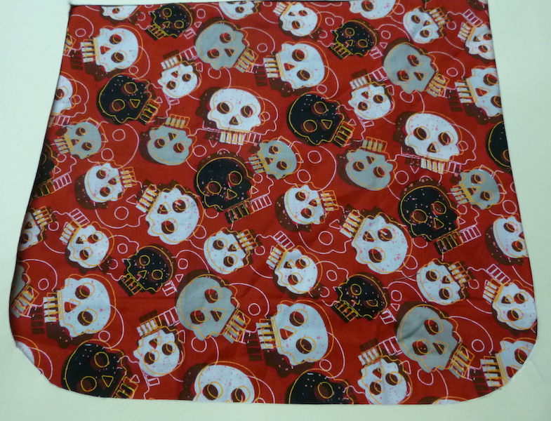 skulls on red flap for messenger bag