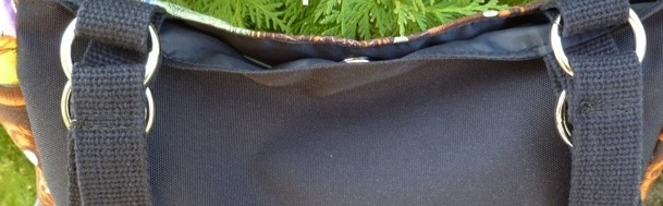 large purse with metal hardware pockets and key clip