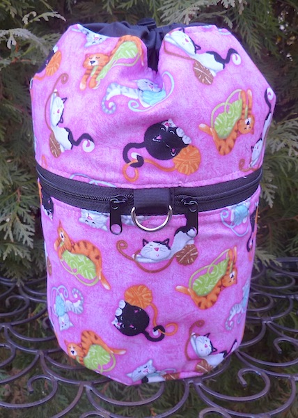 pink knitting bag with cats and yarn