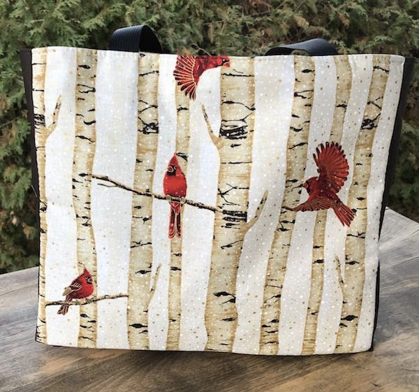 cardinals in winter tote bag