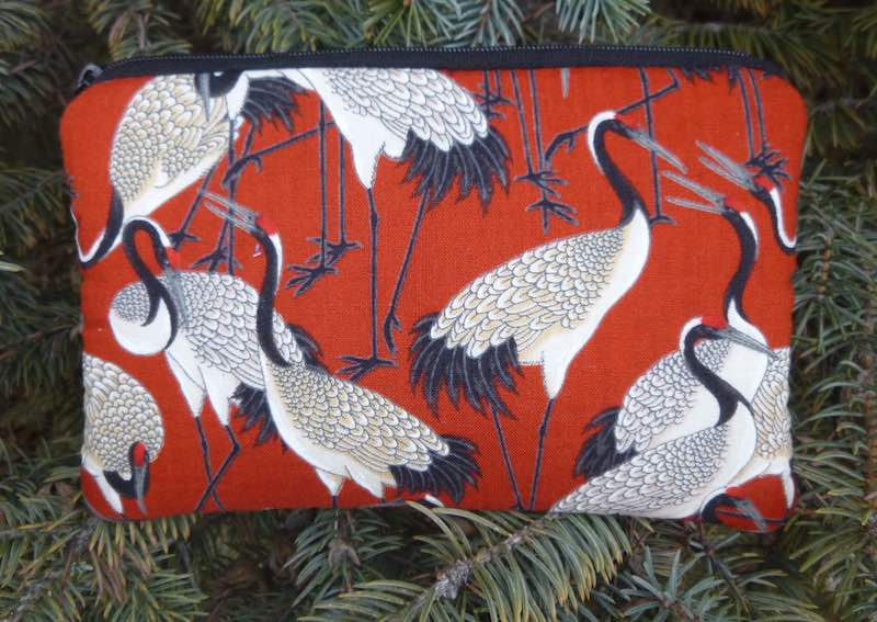 Padded pouch with pockets for essential oils with Japanese cranes
