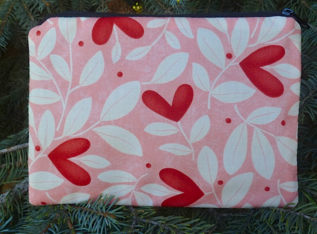 zippered makeup bag with hearts
