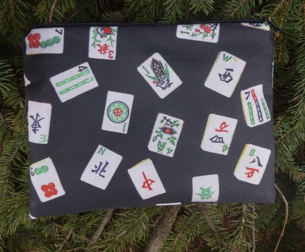 mahjong tiles on black pouch for mahjong card and coin