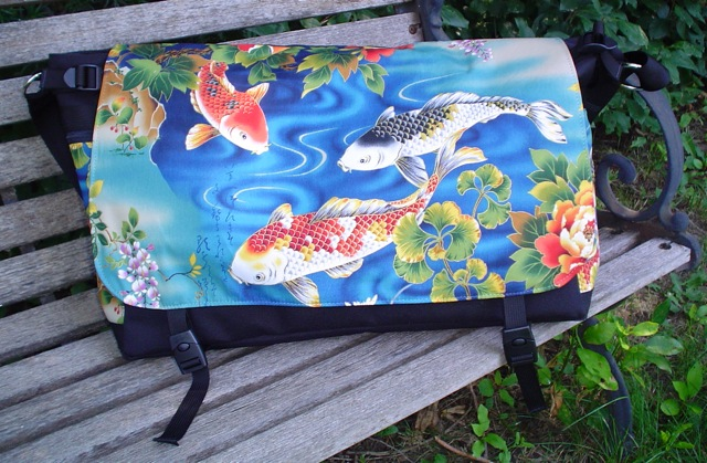 large vegan messenger bag with inside and outside pockets