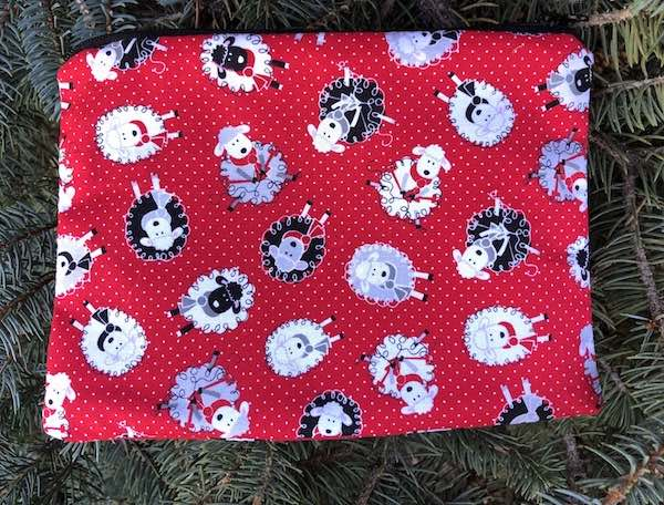 Knitting sheep on red and white pin dot zippered bag