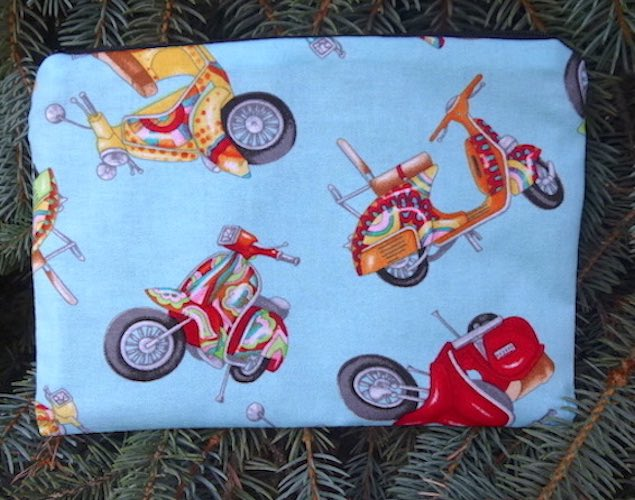 Scooters on blue zippered bag