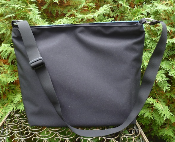large zippered purse with adjustable shoulder strap