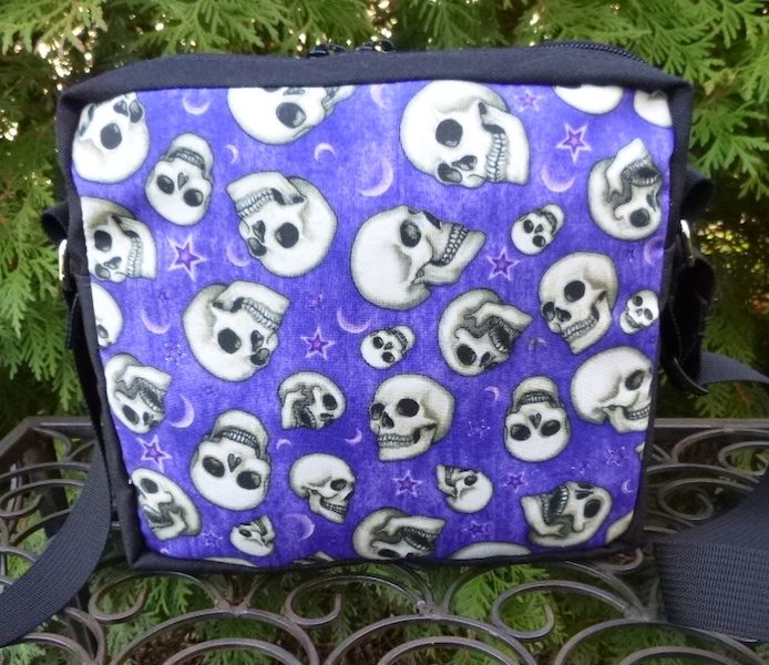 skulls on purple shoulder bag