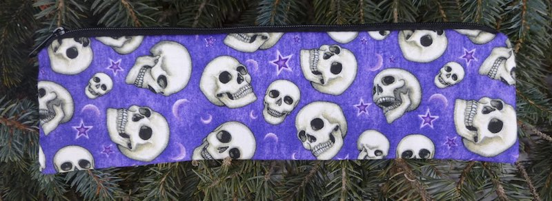Skulls on purple pouch for paper straws and reusable straws eco friendly