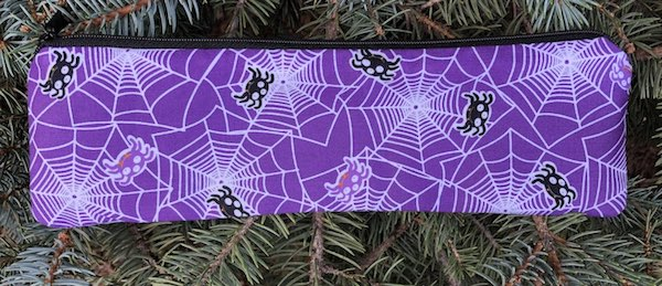 spiders on purple zippered pouch for chopsticks