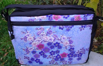 shoulder bag with zippered pocket on the back