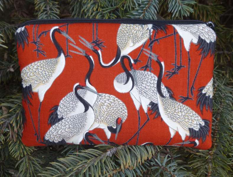 Cranes on red padded case for essential oils, the Essence