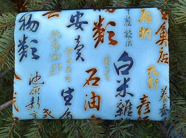 Kanji on blue zippered bag, The Scooter