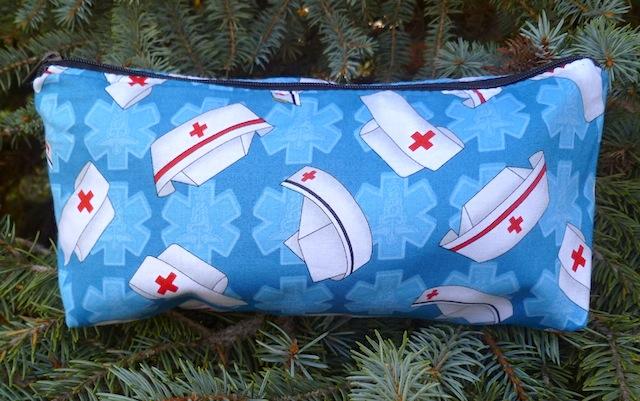 Nurses caps on blue flat bottom bag, The Zini