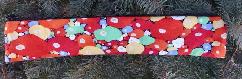Red Bubbles low profile case to carry a reusable straw, The Skinny Strawz