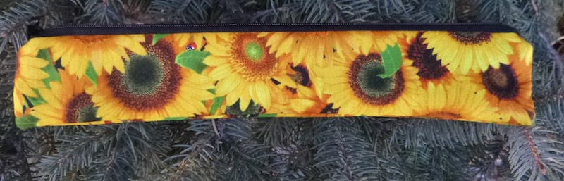 Sunflowers low profile case to carry a reusable straw, The Skinny Strawz