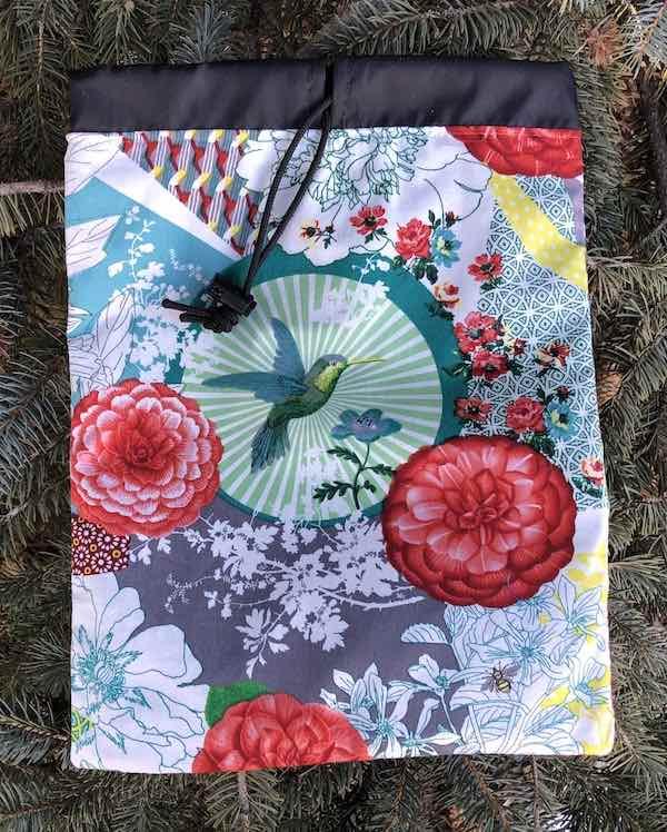 Circling Hummingbird Flatie Jr. a flat drawstring bag