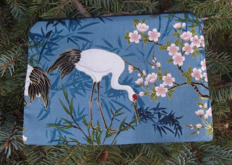 Cranes on blue zippered bag, The Scooter