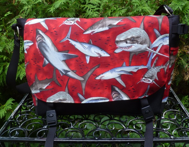 Sharks on red Lynx Deluxe Messenger Bag