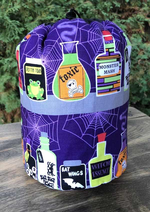 Scary Shelf SueBee Round Drawstring Bag