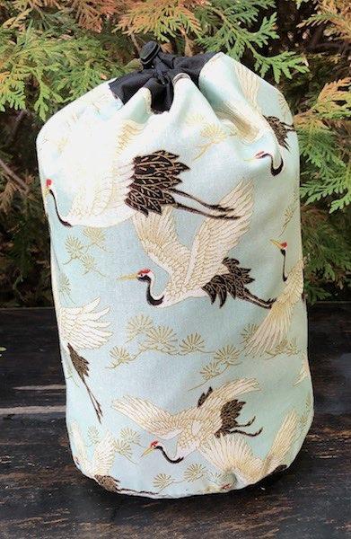 Cranes on Blue SueBee Round Drawstring Bag