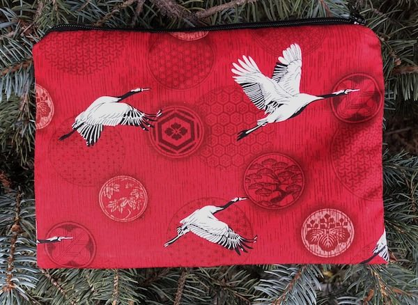 Crane Medallions on red zippered bag, The Scooter