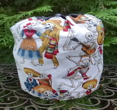 Fiesta de los Muertos white SueBee Round Drawstring Bag