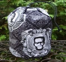 Framed Monsters SueBee Round Drawstring Bag