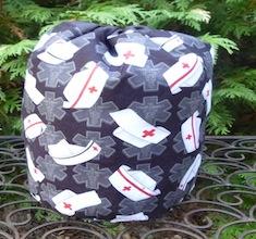 Nurses Caps on black SueBee Round Drawstring Bag