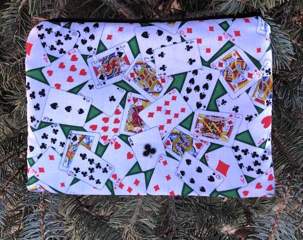 Playing Cards on green zippered bag, The Scooter
