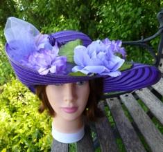 Purple hat with upswept brim