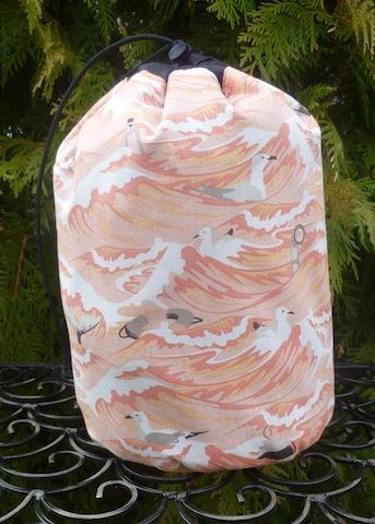 Sea Debris in coral SueBee Round Drawstring Bag