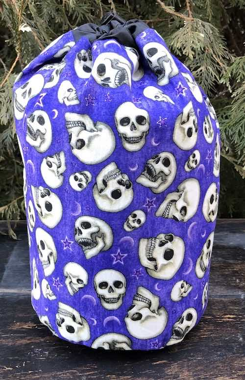 Speaking Skulls SueBee Round Drawstring Bag