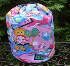 Tako Wako in pink SueBee Round Drawstring Bag